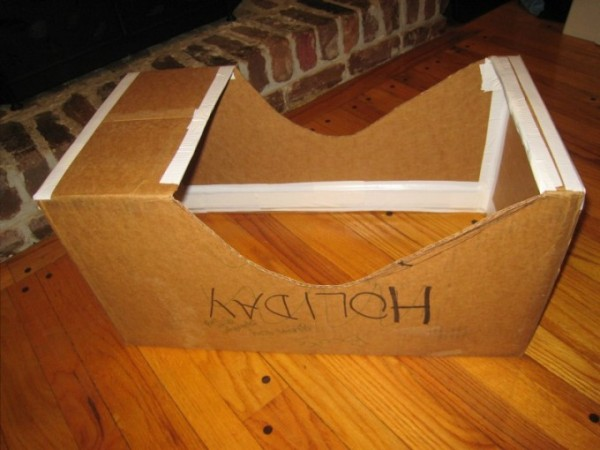 The box after a first cut is made for the cockpit, and duct-tape applied for reinforcement